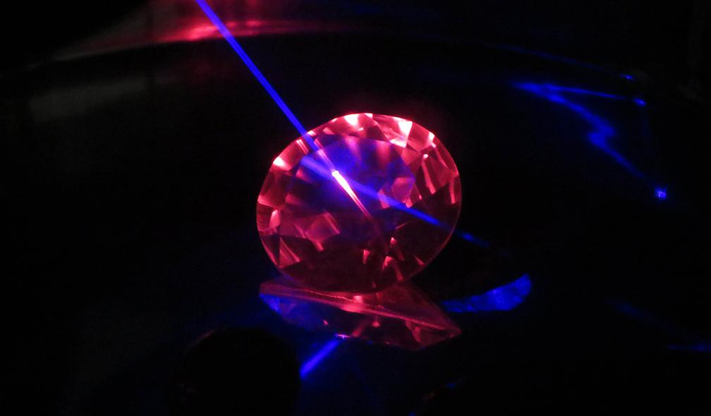 Synthetic flame-fusion colour-change sapphire seen under laser excitation